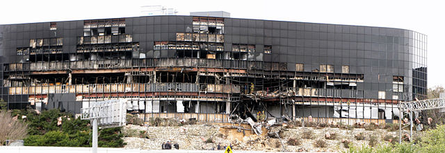 """Damage to Echelon complex from 2010 plane crash"" by Jasleen Kaur from USA - surveying the damage (direct link). Licensed under Creative Commons Attribution-Share Alike 2.0 via Wikimedia Commons - http://commons.wikimedia.org/wiki/File:Damage_to_Echelon_complex_from_2010_plane_crash.jpg#mediaviewer/File:Damage_to_Echelon_complex_from_2010_plane_crash.jpg"